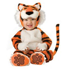 This baby tiny tiger costume is the perfect costume for baby's first Halloween. - Lined zippered bodysuit with attached tail - Booties - Headpiece with ears - SKU: CA-014774