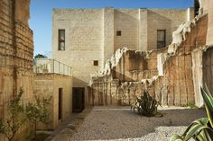 Hotel designed out of abandoned excavation site of stone quarry. 'Cave Bianche Hotel' designed by studio cusenza+salvo. Located on the island of Favignana, Italy.