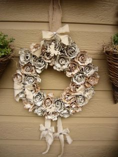 a wreath made from egg cartons ... of the boxes I made roses ... used two color boxes. old look given with white paint ..