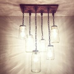 PLEASE KNOW THAT REGARDLESS OF SIZE, WE PROCESS ORDERS IN THE ORDER THEY ARE RECEIVED, TURN AROUND TIME IS 1-2 WEEKS PER ORDER!  This handmade industrial, rustic, one of a kind chandelier will take you back to simple, practical things. The neat light fixture idea will make everyone stop, stare and wonder!  In the picture above we have a zig-zag style 6 mason jars chandelier, we used quart and half-gallon jar sizes with a E26 bulb porcelain socket, jars are hanging between 16-32(from the…