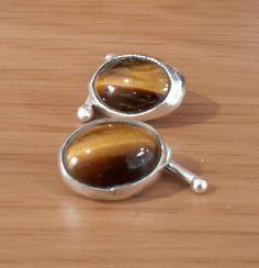 Tigers eye cufflinks set in fine silver