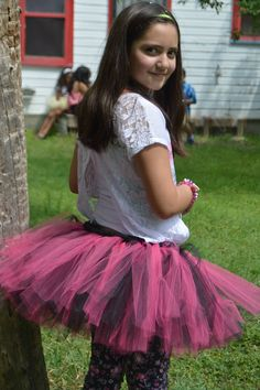 A personal favorite from my Etsy shop https://www.etsy.com/listing/529485483/neon-pink-black-tutu-wrapped-with-black