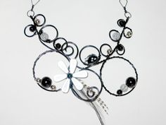 Necklace in wire wrapped aluminium, feathers and flower, beatle beads (black, silver and white)