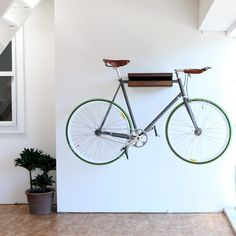 11 Space-Saving Indoor Bike Storage Solutions - - From super sturdy ceiling hooks to surprisingly chic floor stands, here are 11 bicycle storage solutions that will work in any size of home—no U-lock necessary. Bicycle Storage Rack, Outdoor Bike Storage, Indoor Bike Rack, Bicycle Rack, Bike Wall Storage, Bicycle Garage, Bicycle Shop, Apartment Therapy, City Apartment