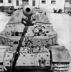 Crew members looming out tbrough their open hatches on this Porsche Tiger (P) 'Elefant' from the s.Pz.Jg.-Abt. 653, 1944 year.