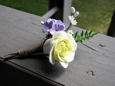 Groom's boutonniere with a soft-yellow rose, lavender lilacs, and lilies of the valley on Etsy, $40.00