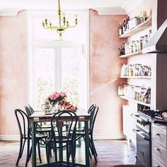 blush walls. chandelier!