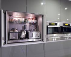 """More than one way to """"hide"""" appliances! I love this huge kitchen 'garage'! Contemporary Kitchen - modern - kitchen - brisbane - Interiors By Darren James"""