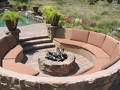 Fabulous circular fire pit seating close to the pool, different cushions.