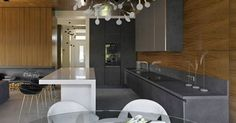 Trendy kitchen - Modern Home into an Artistic Feat of Design