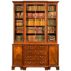 Georgian Mahogany Breakfront Bookcase | From a unique collection of antique and modern bookcases at https://www.1stdibs.com/furniture/storage-case-pieces/bookcases/