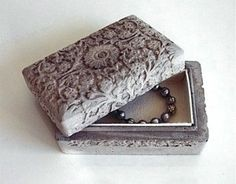 Very unique jewelry box. Concrete embossed with a baroque pattern.
