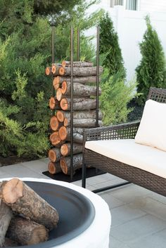 Transition your backyard for cooler temps. Pull free-standing patio furniture around the fire pit. Nearby firewood and a few cozy throws keep friends and family comfortable. See how Room For Tuesday extends the life of her patio.