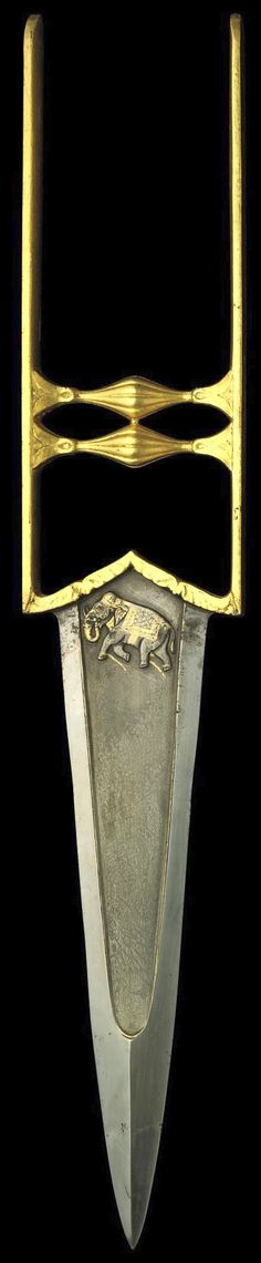 Indian katar, 18th century, double-edged tapering blade with armour-piercing tip and a depressed central panel of watered steel, each side with a raised gilt depiction of a chained elephant with inset stones for eyes, the gilt hilt of typical form, the cross bars terminating in lotuses, 18¼in. (46.4cm.) long.