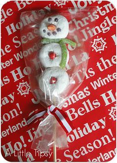 The kids could make this as a craft at a christmas party!!! So Cute. Snowman from powdered donuts...so cute