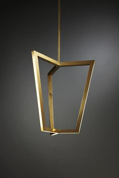 Triptyx pendant light by Melbourne based Christopher Boots. Asterix: A Family of Geometric Brass Chandeliers with inlaid LED.