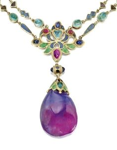 Pendant detail of an Art Nouveau necklace by Louis Comfort Tiffany of Tiffany & Co., circa 1914-1927. Champlevé enamel, emeralds, and an sapphire drop.