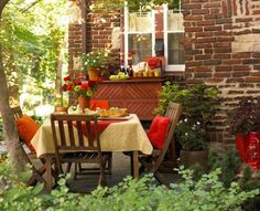 Cute place to put the table and patio. Red and cream add snap!