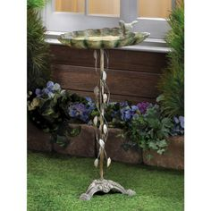"""Verdigris Leaf Birdbath - Balanced at the edge of a broad green leaf, a sparrow lifts his voice in a joyous springtime song. The distressed finish of this Verdigris Leaf Birdbath gives it the appearance of a well-weathered antique. Made of cast iron and wrought iron.An enchanting garden decoration that serves as a welcome watering stop for thirsty birds! Dimensions:27½"""" tall x14.8"""" wide x 12.2"""" deep"""