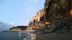 Sunset on the beach in Tropea, Italy.