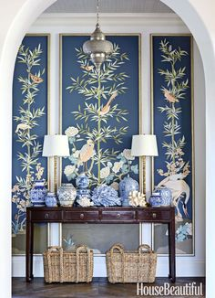 """""""I like making a statement in an entry,"""" says designer Summer Thornton, who commissioned custom panels and massed blue-and-white porcelain for a Florida home's foyer."""