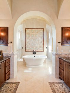 Master bathroom opening to a beautiful tub and hidden tiled shower behind.