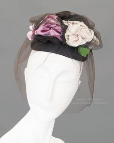Black satin hat with black, pink & white roses with netting overlay and hair combs. c.1945-55. Label: Mr. John. FRC1991.05.012