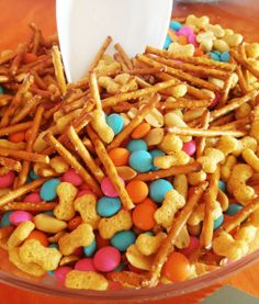 "Puppy-themed Party Ideas: ""Kibble & Bits"" snack mix made from Scooby-Doo cereal, peanuts, pretzel sticks, and chocolate candies"