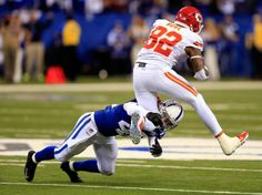 INDIANAPOLIS, IN - JANUARY 04: Wide receiver Dwayne Bowe #82 of the Kansas City Chiefs is tackled by defensive back Corey Lynch #42 of the Indianapolis Colts during a Wild Card Playoff game at Lucas Oil Stadium on January 4, 2014 in Indianapolis, Indiana. (Photo by Rob Carr/Getty Images)