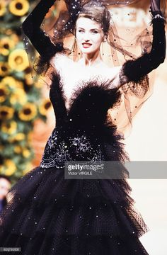 A model walks the runway at the Torrente Haute Couture Fall/Winter 1992-1993 fashion show during the Paris Fashion Week in July, 1992 in Paris, France.