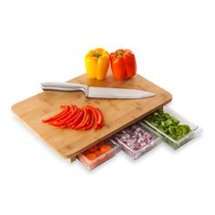 Awesome! Cutting board with storage drawers to organize your chopped food!