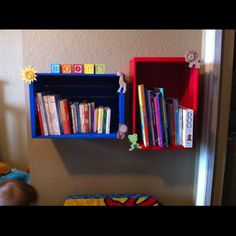 Kids reading corner! Wooden crates spray painted, decorated with little wooden animals from Michaels, then hung in kids bedroom.