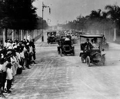 A 1908 Bangkok motorcar parade.....as the growing popularity of cars becomes apparent throughout higher-class circles, many new paved roads ...