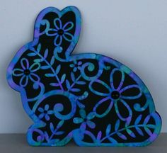 I made this card using the Bunny Flourish shape card by Silhouette Cameo