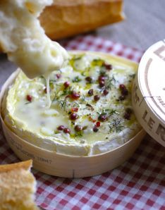 Baked camembert: Remove the paper from a camembert in a wooden box (Rustique is the best!), thinly slice off some of the top rind and put the cheese back into the box. Sprinkle with fresh thyme/rosemary/oregano, salt crystals and some pink or ground black pepper or chilli flakes. Drizzle with Muscat wine/sherry/kirsch/olive oil; bake 10 mins in a very hot oven. Eat with fresh, crusty bread. | FrenchFlakes