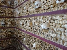 'Stop here and consider the fate that will befall you.' The Bones Chapel at the Church of Carmo in Faro in the Algarve, the southern part of Portugal. The bones and skulls which line the walls are those of over 1.200 Carmelite monks that were exhumed from the nearby church cemetery. A grim reminder of the brevity of human existence. Algarve, Lisbon, Cemetery, Skulls, Bones, Portugal, Southern, Chandelier, Ceiling Lights