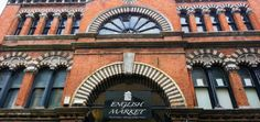 Exterior of English Market Princess Street side of brick facade with Moorish arches