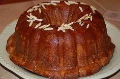 Bailey s Bundt Cake With Irish Cream Glaze from Food.com:   This is a very impressive bundt cake made with Bailey's Irish cream and comes with a scrumptious glaze - topped with sliced almonds and a dollop of whip cream on the side makes it extra special.