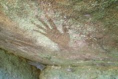 This hand stencil is one of the main highlights of an ancient Aboriginal art site discovered in a Sydney suburb. (Photo: ABC/Anne Barker.)
