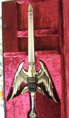 I'd play me some Slayer with this!  -   ESP Excalibur sword guitar
