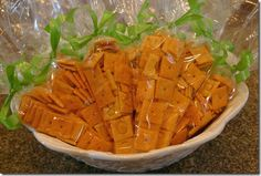 easter school treat ... Take a cone-shaped clear cello treat bag and fill it with a kid friendly, orange finger food (CheezeIts, Cheetos, Goldfish, etc.) add a green ribbon/pipecleaner.  Use Cheddar bunnies