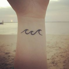 Little wrist tattoo of three waves on Marie.