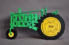 John Deere Green Farm Tractor Wooden Toy Puzzle Hand Cut. $13.49, via Etsy.