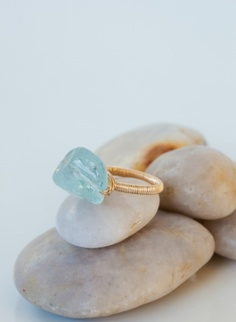 The Ryan: Meet Ryan. Ryan is gorgeous and free-spirited with a glowing personality.  Sterling silver ring tightly wrapped with gold-filled or sterling silver wire, feauturing a beautiful raw semi-precious aqua quartz stone that glows in the light.