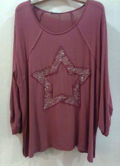Camiseta con estrella en palletes