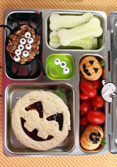 This Halloween bento box has a little bit of everything: cucumber bones, a jack-o-lantern pb&j, clementine pumpkins, a green jelly blob monster and a spider made from a crispy rice treat stacked with eight icing eyes. Here's How to Make Clementine Bento Box Lunch For Kids, Cute Bento Boxes, Kids Lunch For School, Healthy Lunches For Kids, Kids Meals, School Lunches, Healthy Food, Comida De Halloween Ideas, Halloween Snacks For Kids