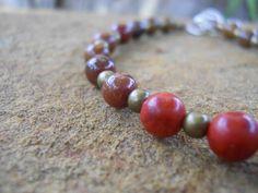 Red coral, leopardskin jasper, red chrysocolla and brass bead bracelet with unakite clasp detail. (BR6). www.feeko.co.za. $20