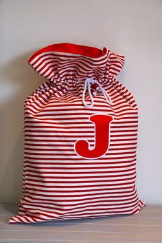 I love the idea of Santa Sacks! Kids leave out old toys for Santa to take to other kids. Perfect way to teach giving.