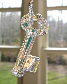 "Key to My Heart Swarovski crystal suncatcher. Show someone they hold the key to your heart with this beautiful and unique suncatcher. A sparkling 50mm (almost 2"") crystal key and small crystal heart are suspended from a 3½"" strand of clear Swarovski crystal beads. The entire"