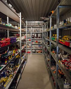 """Tom Lucieer is a retired railway commissioner, who has built one of the world's largest private Lego collections. Picture """"The Lego Man of Angaston #1 by brettm8, via Flickr."""" UpstateBrick's take: """"One heck of a shelved, organized LEGO collection. Check out the vintage London Buses next to the Purple Harry Potter Buses."""""""